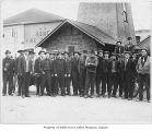 Volunteer Fire Department personnel standing on the street outside station, Kent, ca. 1915