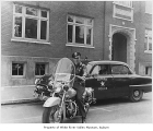 Auburn policemen Larry Scyler and Ed Dray outside City Hall, Auburn, ca. 1960