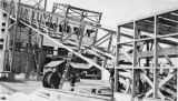 Bottom of chip conveyor during the construction of the Bloedel, Stewart and Welch kraft pulp mill...
