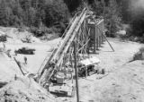 Gravel plant conveyor belt being built during construction of the Bloedel, Stewart and Welch kraft...