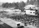 Beams being put in place for machine room during construction of the Bloedel, Stewart and Welch...