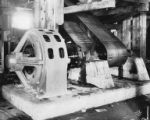 Large belt and pulley inside of mill, possibly at the Bloedel, Stewart and Welch Company's Red...