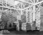 Interior of box factory with stacks of box lumber,  Bloedel-Donovan Lumber Mills, ca. 1926