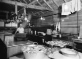 Interior of camp kitchen with cook Bob Larsen, Bloedel, Stewart & Welch logging operations,...