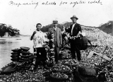 Asian workers stringing oyster shells on wires, unidentified oyster bed, Washington