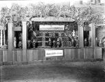 Yakima Valley fruit stand, with advertisements for Western Empire Land Co., most likely at a fair,...
