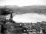 Large well spouting water into field, Pomona, Washington, ca. 1913