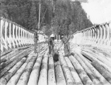 Loggers constructing Benson log raft with help of cradle on the Columbia River, vicinity of...
