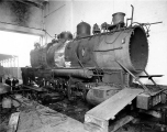 Great Northern Railroad engine being overhauled, Puget Sound Machinery Depot, Seattle, Washington,...