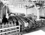 Sacks of fish meal in warehouse at the Hanford Street Wharf, Seattle, Washington, n.d.