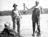 Two men with geoduck catch, Washington, n.d.