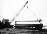 Crane loading lumber for U.S. government, Puget Mill Co., Port Gamble, Washington, 1918