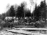 Bordeaux Brothers Logging Co. crew sitting on Black Hills Northwestern Railway train car, Mason...