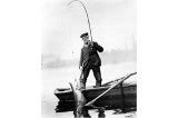 Fisherman landing salmon with pole and gaff from small boat, Willamette River, Oregon, September...
