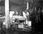 Filling salmon cans, unidentified cannery, Pacific Coast, n.d.