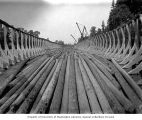 Logs floating inside cradle, Columbia River near Stella, Washington, ca. 1903