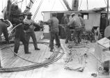 Crew coiling cable onto deck of U.S. Cableship Dellwood, May 19, 1924