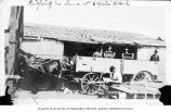 Men dumping clams into horse-drawn wagon for weighing, Sea Beach Packing Works, Copalis, ca. 1916