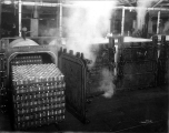 Canned salmon being heated in retort, unidentified cannery interior, Washington, ca. 1913