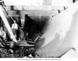 Workers in partly built tunnel, Cushman Dam construction, August 4, 1924