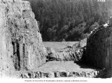 Excavation and rock trimming for lock and gate sill, Bonneville Dam construction, ca. 1937-1938