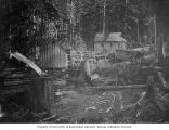 Group of buildings with treestumps in foreground, possibly the Penn Mining Company camp at Goat...