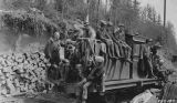 Men seated and standing on gas locomotive engine returning from a road inspection trip, vicinity...