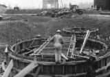 Man working on salt cake and sulphur storage, construction of the Bloedel, Stewart and Welch kraft...