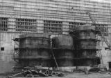 Liquor storage tanks during the construction of the Bloedel, Stewart and Welch kraft pulp mill at...