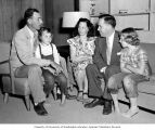 Congressman Henry M. Jackson visiting the Dunn family in their living room on the Dunn Farm near...
