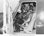 Senator Henry M. Jackson sitting in the gunner co-pilot seat of a UH1B helicopter, Tan Son Nhut...