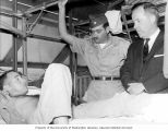 Senator Henry M. Jackson visiting an injured soldier, Captain James P. Leighton, during a tour of...