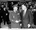 Senator Henry M. Jackson standing with General Alfred M. Gruenther during a ceremony recognizing...