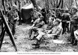 Senator Henry M. Jackson talking with soldiers during a military strategy meeting, U.S. Army, 1st...