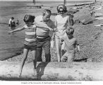 Henry M. Jackson his wife, Helen Hardin Jackson, walking on the beach with their children, Peter...