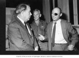 Senator Henry M. Jackson talking with Israeli Minister of Defense, Moshe Dayan, and an...