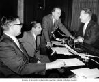 Senator Henry M. Jackson in discussion with Oklahoma Senator Fred Harris, Virginia Senator Harry...
