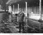 Senator Henry M. Jackson dressed in military fatigues standing in front of Thai Hoa Palace, Hue,...