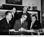 Senator Henry M. Jackson with Secretary of Agriculture, Orville L. Freeman, signing soil and water...