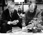 Alexander Solzhenitsyn autographing books for Senator Henry M. Jackson in his office, during...