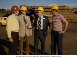 Senator Henry M. Jackson standing with unidentified men in hard hats during a visit to the Port of...