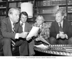Senator Henry M. Jackson examining a document with Washington State Congressmen Don Bonker, Lloyd...