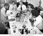 Senator Henry M. Jackson sitting with African-American reporters during a breakfast meeting,...