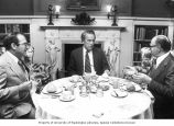 Senator Henry M. Jackson sitting at a table during a private dinner meeting with Israeli ...