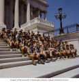 Senator Henry M. Jackson and Senator Slade Gorton sitting with a Boy Scouts troop on the steps of...