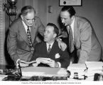 Representative Henry M. Jackson sitting at his desk between Mike Mansfield and Congressman John...