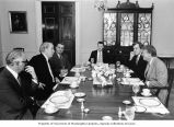 Senator Henry M. Jackson and others eating dinner in the family dining room during a meeting with...