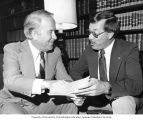 Bellevue Police Chief Donald P. Van Blaricom sitting with Senator Henry M. Jackson in his office,...