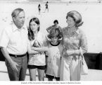 Senator Henry M. Jackson, his wife Helen Hardin, and children, Anna Marie and Peter, posing for a...