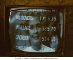 Television screen with the voting tally for the Democratic presidential nomination, showing...